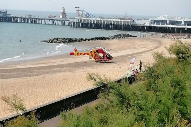 An air ambulance landed on Clacton beach this morning after a body was pulled from the sea. Emergency services were called to Clacton Pier just after 10.30am this morning (August 10).