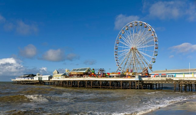 Traditional Victorian seaside pier. This is the Central Pier with fairground rides in the seaside town of Blackpool, Lancashire, UK.