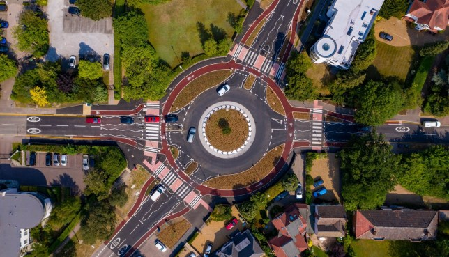 Mandatory Credit: Photo by Terry Harris/REX (10740407d) Aerial views of Britain's first Dutch-style roundabout, which prioritises cyclists, opens in Cambridge. Britain's first Dutch-style roundabout opens in Cambridge, UK - 10 Aug 2020 The ?2.3m Fendon road roundabout, in Cambridge, became the first in the UK to give cyclists the right of way over motorists when it opened on July 31.Cyclists have an outer ring, with cycle crossings over each of the four approach roads in a contrasting red tarmac.