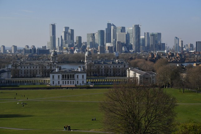 A view of the financial towers and bank offices of Canary Wharf from Greenwich Park in London on March 26, 2020 after the government ordered a lockdown to help stop the spread of the new coronavirus.