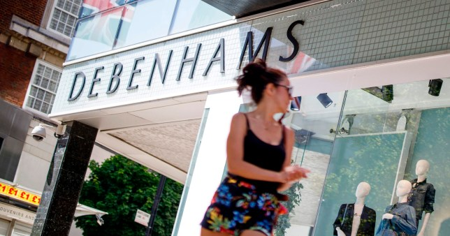 A woman walks past closed Debenhams department store on Oxford Street in central London's main high street retail shopping area on May 29, 2020 ahead of some shops reopening from their coronavirus shutdown from next week. - The UK Prime Minister announced on May 28 that some English schools and shops would reopen from next week people would a little more freedom to meet others in public as he tried to plot Britain's path through a health disaster that has officially claimed 37,837 lives -- second only to the United States -- and devastated the economy. (Photo by Tolga AKMEN / AFP) (Photo by TOLGA AKMEN/AFP via Getty Images)