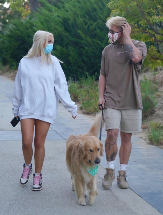Jake Paul takes his dog for a walk with Tana Mongeau in Calabasas