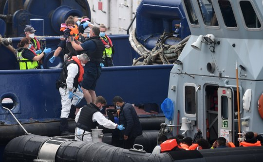 UK Border Force bring in migrants including small children found off the coast of Dover Port in Dover, Britain, 14 August 2020. Migrants from Syria and other countries are continuing to arrive along the coast of Britain in their quest for asylum.