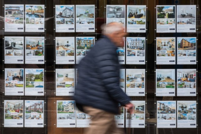 A pedestrian passes an estate agents window advertising properties for sale in London, U.K. on Tuesday, March 26, 2019. With Britain's future outside of the EU still as unclear as ever, the London property market is taking the biggest hit. Photographer: Chris Ratcliffe/Bloomberg via Getty Images