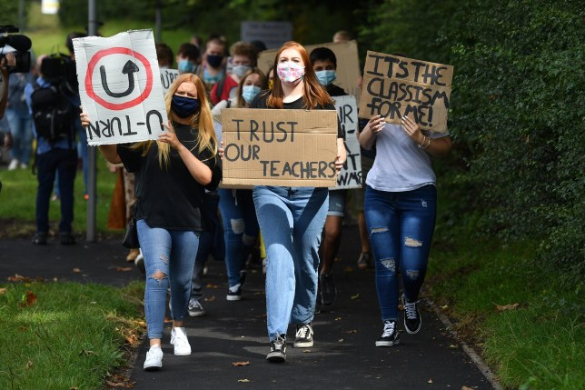 Students from Codsall Community High School march to the constituency office of their local MP Gavin Williamson, who is also the Education Secretary, as a protest over the continuing issues of last week's A level results which saw some candidates receive lower-than-expected grades after their exams were cancelled as a result of coronavirus.