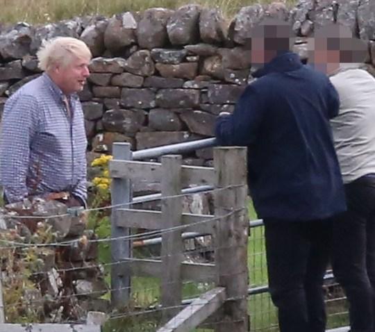 Boris Johnson speaks with neighbours at Applecross.