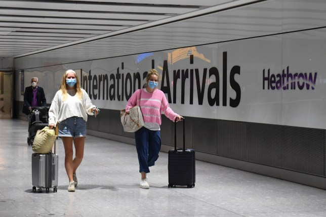Passengers wearing face masks as they arrive at Heathrow Airport