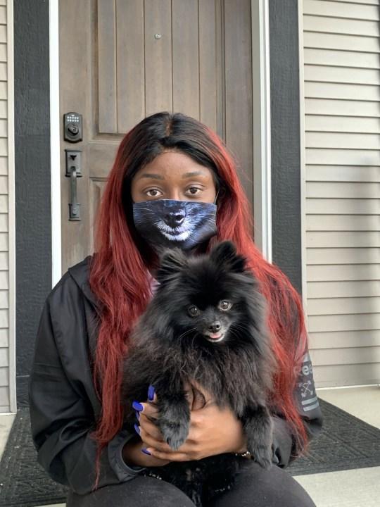 woman wearing matching dog mask