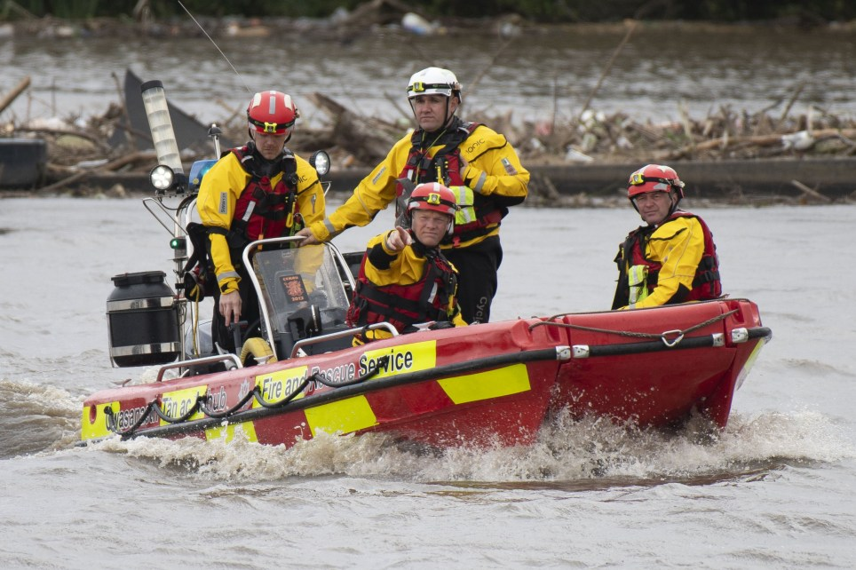 CARDIFF, WALES - AUGUST 25: The Fire and Rescue Service search the River Taff using a boat after reports a woman has fallen in the water on August 25, 2020 in Cardiff, Wales. The Met Office have issued a yellow weather warning for wind and rain with gusts of 65mph possible inland and 70mph or more possible around coastal areas as Storm Francis passes over the UK. The storm is the second named storm in August and follows Storm Ellen last week. (Photo by Matthew Horwood/Getty Images)