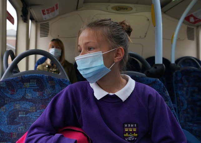 a young student wearing a face mask