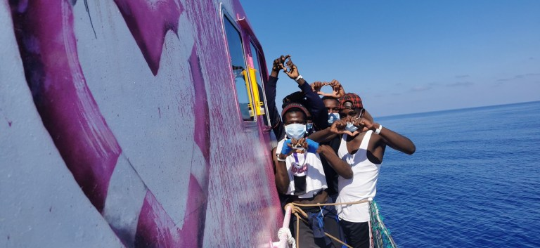 Refugees rescued on a boat funded by Banksy