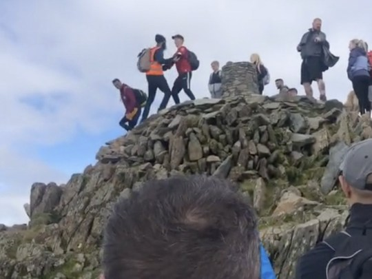 Scuffle on top of Snowdon after queue pusher tries to summit (Picture: @ kenanramsay/TikTok)
