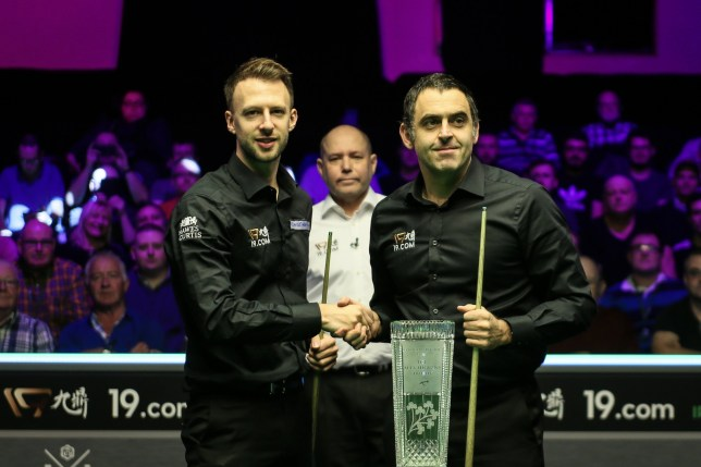 BELFAST, NORTHERN IRELAND - NOVEMBER 17: Judd Trump (L) of England shakes hands with Ronnie O'Sullivan of England prior to their final match on day seven of 2019 Northern Ireland Open at Waterfront Hall on November 17, 2019 in Belfast, Northern Ireland. (Photo by Tai Chengzhe/VCG via Getty Images)