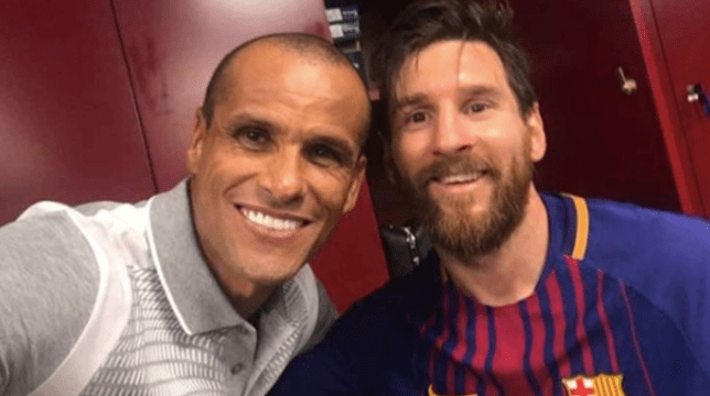 Rivaldo and Lionel Messi pose in the Barcelona dressing room