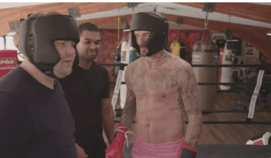 David Beckham goes topless as he challenges James Corden in boxing match f
