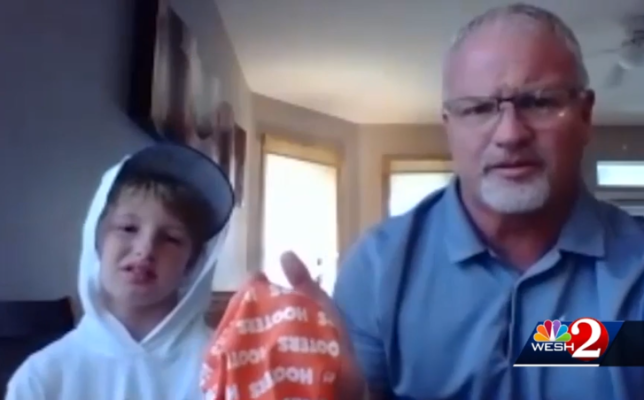 Greg Golbra, his son Ian, and the offending Hooters mask