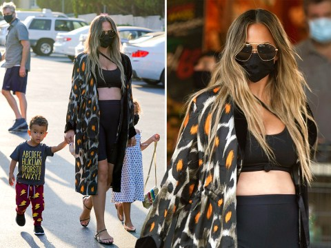 Chrissy Teigen reveals baby bump in crop top as she and John Legend go grocery shopping