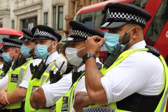 Policemen wearing face masks