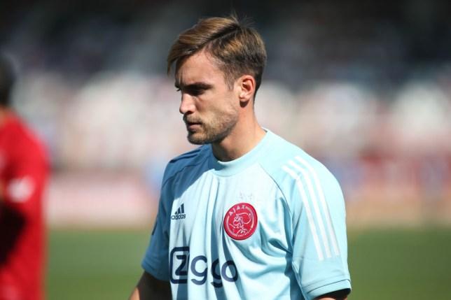 Manchester United transfer target Nicolas Tagliafico looks on ahead of Ajax's clash with Rotterdam