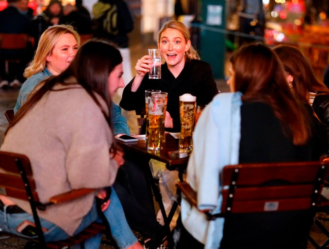 A group of friends drinking at a pub.