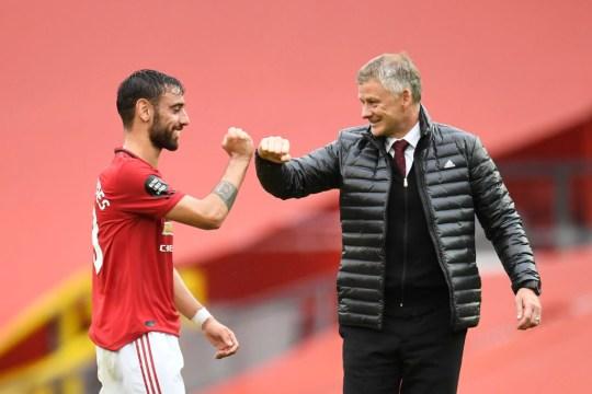 Bruno Fernandes and Ole Gunnar Solskjaer celebrate after Manchester United's win over Bournemouth