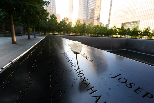 A rose is placed along a victims name at The National September 11 Memorial & Museum in World Trade Center.