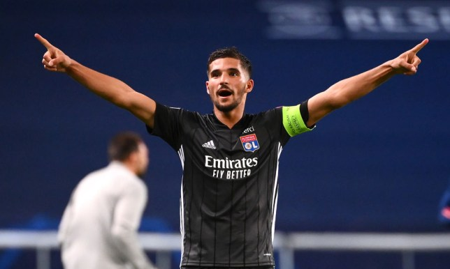 Houssem Aouar of Olympique Lyon celebrates following his team's victory in the UEFA Champions League Quarter Final match between Manchester City and Lyon at Estadio Jose Alvalade on August 15, 2020 in Lisbon, Portugal.