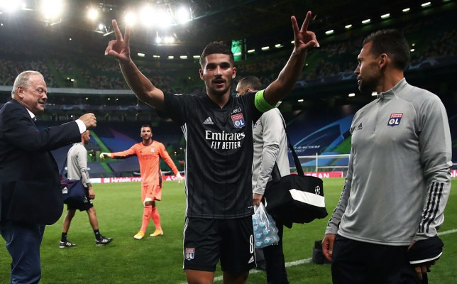 Houssem Aouar of Lyon celebrates their win at full time during the UEFA Champions League Quarter Final match between Manchester City and Lyon at Estadio Jose Alvalade on August 15, 2020 in Lisbon, Portugal.