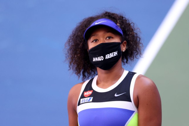 Naomi Osaka of Japan wears a protective face mask with the name, Ahmaud Arbery stenciled on it after winning her Women's Singles third round match against Marta Kostyuk of the Ukraine on Day Five of the 2020 US Open at USTA Billie Jean King National Tennis Center on September 04, 2020 in the Queens borough of New York City. Ahmaud Arbery, was an unarmed 25-year-old African-American man, was pursued and fatally shot while jogging in Glynn County, Georgia.
