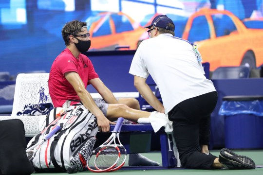 Dominic Thiem of Austria is worked on by trainer Clay Sniteman after the second set during his Men's Singles semifinal match against Daniil Medvedev of Russia on Day Twelve of the 2020 US Open at the USTA Billie Jean King National Tennis Center on September 11, 2020 in the Queens borough of New York City.
