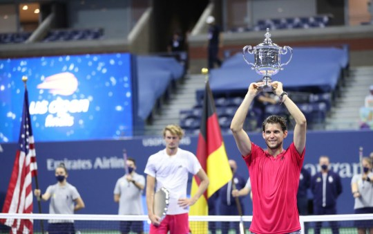 Dominic Thiem (R) of Austria celebrates with championship trophy after winning in a tie-breaker during his Men's Singles final match against Alexander Zverev (L) of Germany on Day Fourteen of the 2020 US Open at the USTA Billie Jean King National Tennis Center on September 13, 2020 in the Queens borough of New York City.