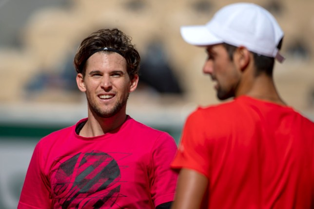 Novak Djokovic of Serbia and Dominic Thiem of Austria converse during their practice match on Court Philippe-Chatrier in preparation for the 2020 French Open Tennis Tournament at Roland Garros on September 26th 2020 in Paris, France.
