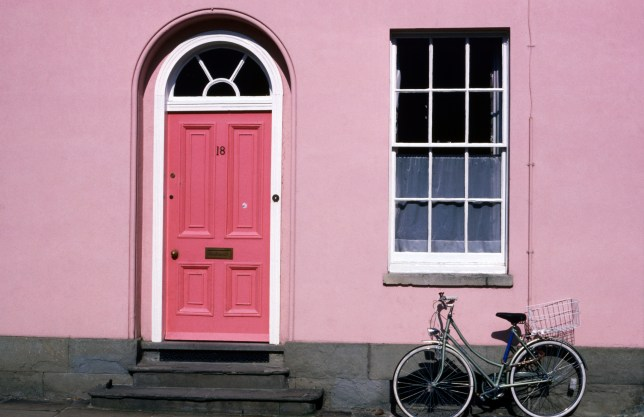 Bicycle leaning against pink house, Oxford, Oxfordshire, England, United Kingdom, Europe