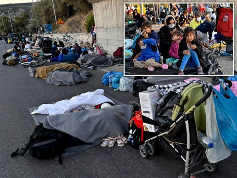Children forced to sleep in the road after fire destroys Greece's largest refugee camp