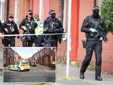 Man fighting for his life after double stabbing in Manchester