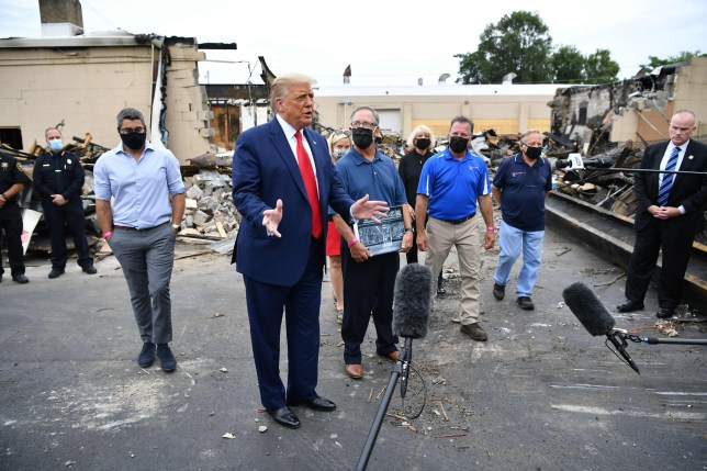 US President Donald Trump speaks to the press as he tours an area affected by civil unrest in Kenosha, Wisconsin on September 1, 2020. - Trump visited Kenosha, the city at the center of a raging US debate over racism, despite pleas to stay away and claims he is dangerously fanning tensions as a reelection ploy. (Photo by MANDEL NGAN / AFP) (Photo by MANDEL NGAN/AFP via Getty Images)
