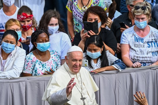 Pope Francis greets attendees as he arrives at the San Damaso courtyard in The Vatican to hold a limited public audience on September 2, 2020 during the COVID-19 infection, caused by the novel coronavirus. - Pope Francis is resuming on September 2, 2020 limited public weekly audiences, six months after the head of the Catholic Church halted the practice because of the coronavirus pandemic. (Photo by Vincenzo PINTO / AFP) (Photo by VINCENZO PINTO/AFP via Getty Images)