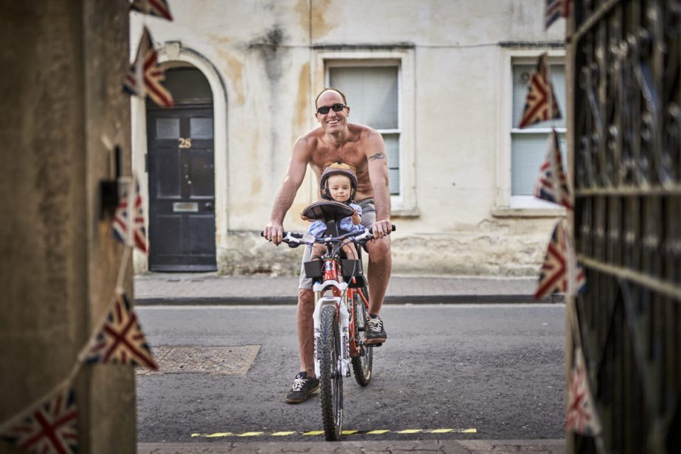 Man and child on a bike