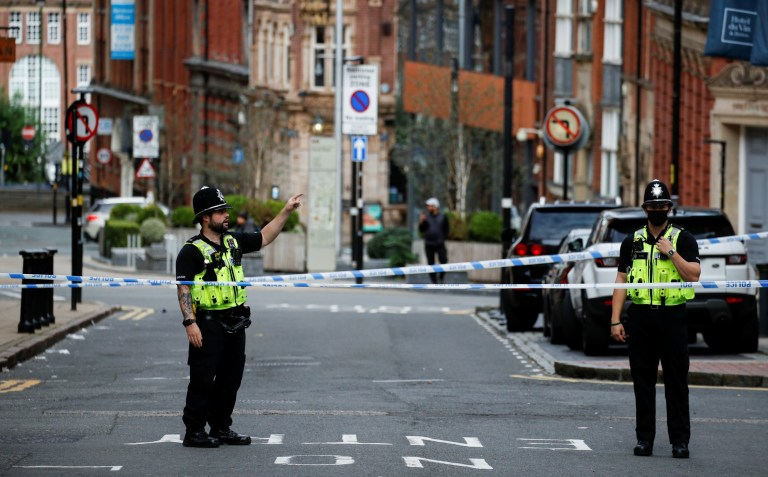 Police officers stand near the scene of reported stabbings in Birmingham, Britain, September 6, 2020. REUTERS/Phil Noble