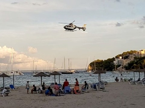 Helicopter flies over beach in Majorca ordering people to go home