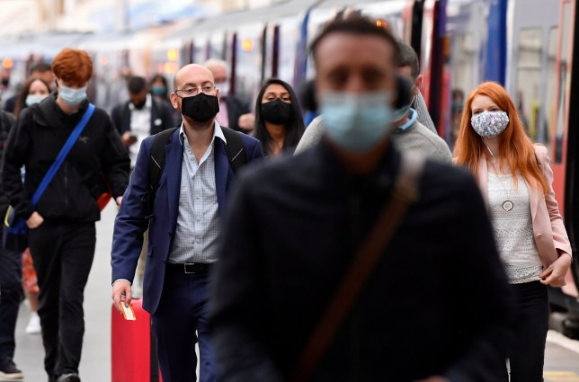 People wearing face masks at a train station