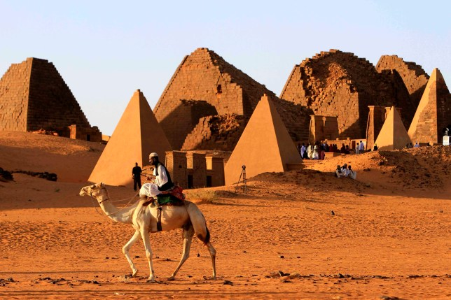 A man rides a camel near pyramids in Merowe, Sudan, 01 February 2016 (Credits: EPA)