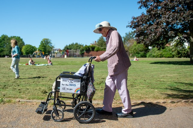 Former nurse Joan Rich, 101, walks through Allenby Park in Felixstowe, Suffolk, to raise money for NHS Charities Together. Mrs Rich, who uses a frame to aid her walking, aims to walk 102 laps of the park before her 102nd birthday on 11 September.