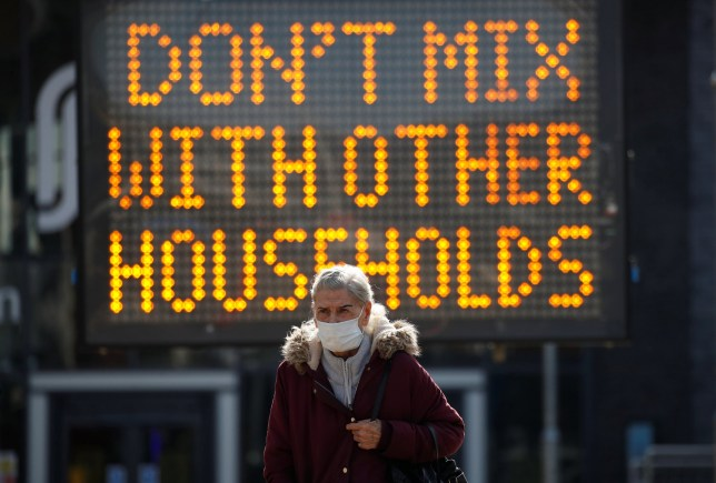 Photograph of a sign in Bolton that says: 'Don't mix with other households'