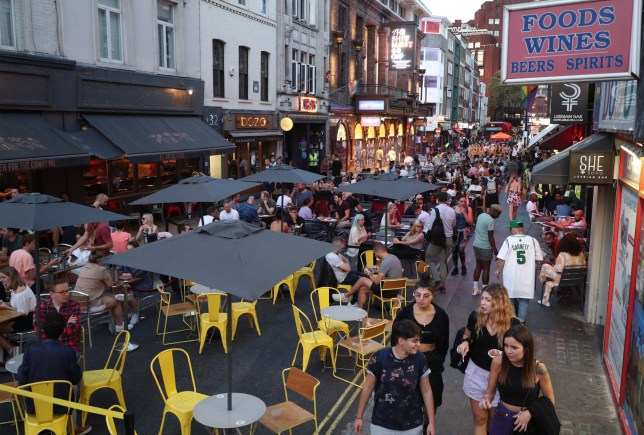 People drinking and dining out in Soho, London, as the Metropolitan Police has said it will deploy resources across the capital to enforce the tighter restrictions on social gatherings. PA Photo. Picture date: Monday September 14, 2020. See PA story HEALTH Coronavirus. Photo credit should read: Yui Mok/PA Wire