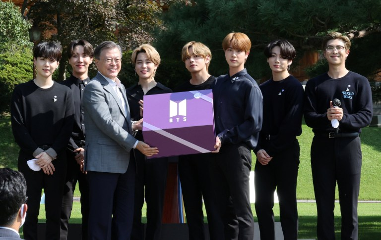 South Korean President Moon Jae-in and members of K-Pop boyband BTS pose for photographs with a gift given by BTS during Youth Day at the Presidential Blue House in Seoul, South Korea, September 19, 2020. Yonhap via REUTERS ATTENTION EDITORS - THIS IMAGE HAS BEEN SUPPLIED BY A THIRD PARTY. SOUTH KOREA OUT. NO RESALES. NO ARCHIVE.