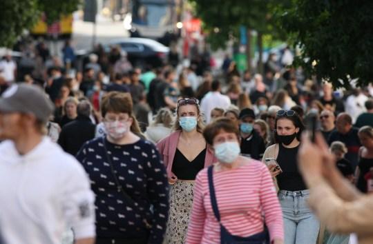 Mandatory Credit: Photo by Adam Vaughan / REX (10782584h) Shoppers in Liverpool city center on Saturday.  Local coronavirus lockdown, Liverpool, UK - September 19, 2020