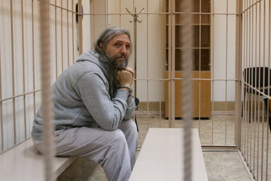 Sergei Torop, one of the leaders of the Church of the Last Testament, sits in a jail cell