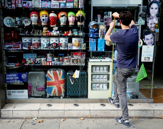 a man outside a souvenir shop in london