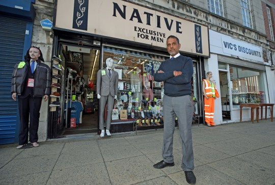 The changing face of the high street. Vijay outisde, Native, the suit store he has owned for 35 years on Victoria Street in Wolverhampton, some six months on from the evening of March 23 when Prime Minister Boris Johnson announced nationwide restrictions. PA Photo. Issue date: Wednesday September 23, 2020. His trade is down 60% from last year, but he is grateful to his loyal customers and his shop remains open. See PA story HEALTH Coronavirus. Photo credit should read: Nick Potts/PA Wire